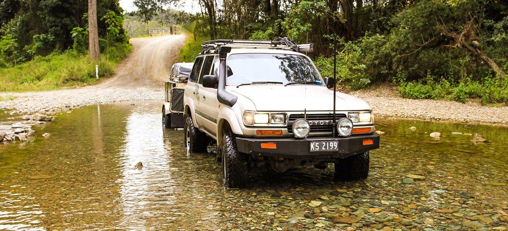 Conondale National Park 4WD car crossing a river – Sunshine Coast